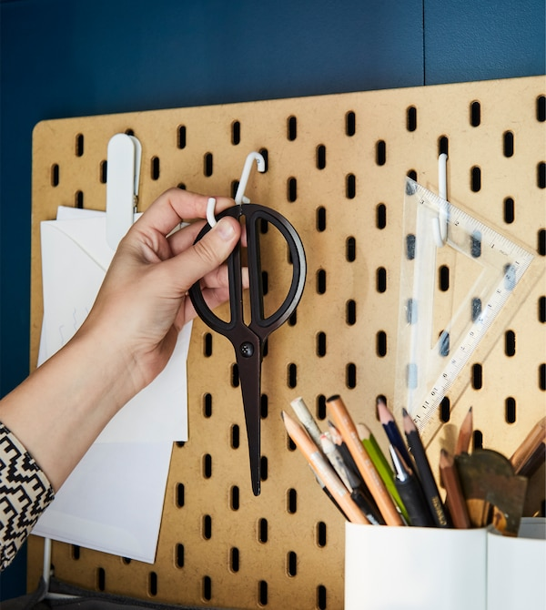 For home office organisation, custom is key. SKÅDIS pegboard in coated fibreboard from IKEA comes in different sizes and has lots of accessories like white-coated steel hooks to hang scissors and other desk supplies.