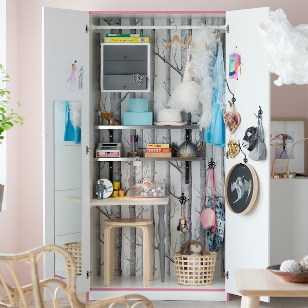 For secret storage ideas in the living room, turn an old wardrobe into a space for toys to get stored away once playtime's over. IKEA has lots of affordable wardrobes like PAX in tanem white with two white doors.