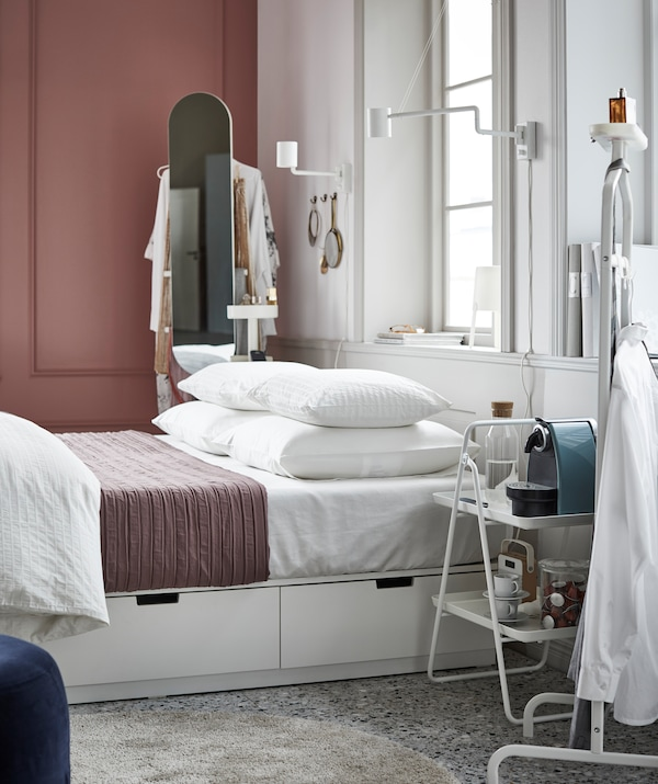 For those who like an ulta-organised bedroom, an IKEA NORDLI bed frame with built-in storage is the perfect match.