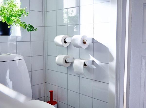 Four IKEA ENUDDEN toilet roll holders mounted next to a toilet.