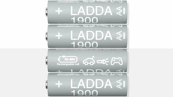 Four LADDA rechargeable batteries, HR6 AA with a battery capacity of 1900 mAh, lie beside each other on a yellow surface.