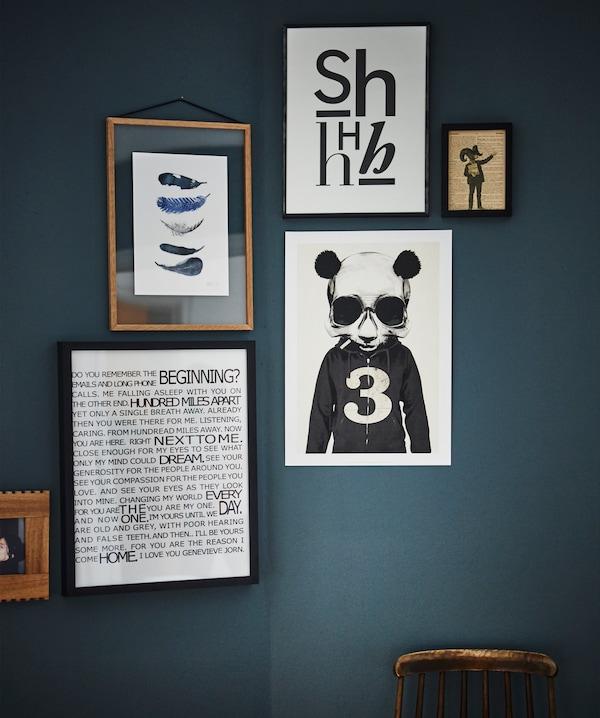 Framed graphic artwork hangs against a dark wall.