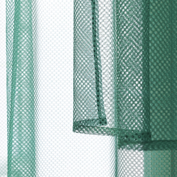 Gambar fabrik jejaring berwarna hijau yang diambil dari dekat.