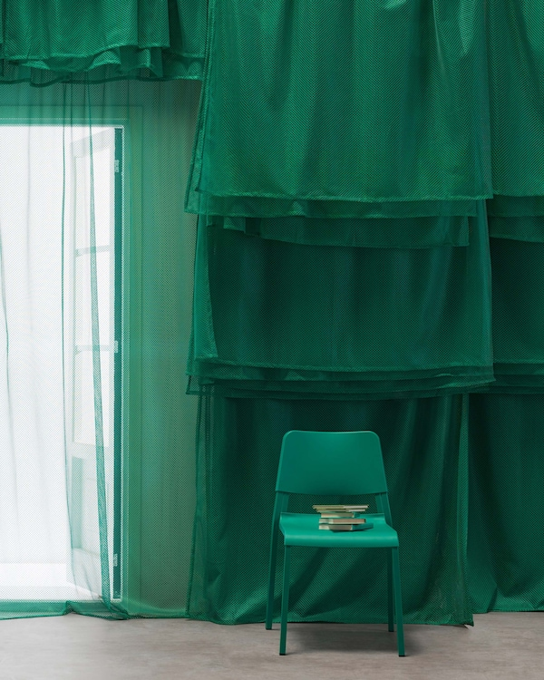 Get a unique look with vivid green GRÅTISTEL net curtains from IKEA. Resembling clothes used in summer sports, they let light through and create privacy. You can also layer them like we've done here.