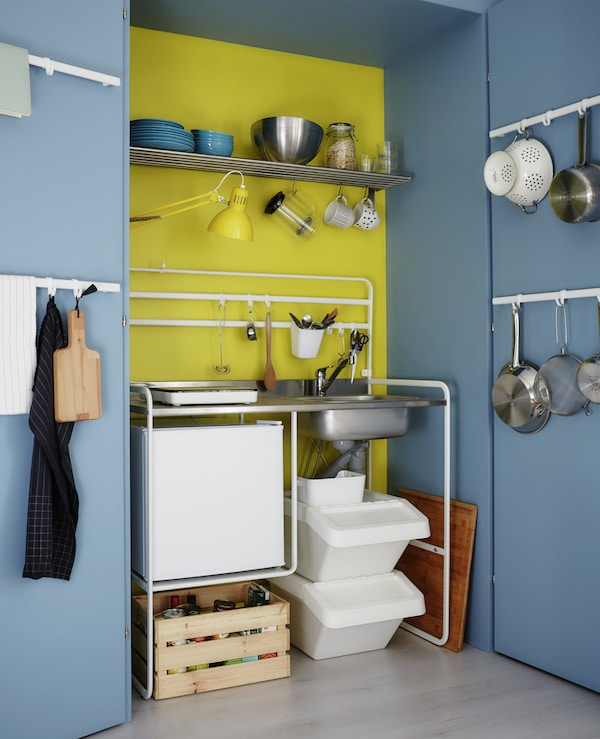 Give a tiny kitchenette all the benefits of a larger kitchen with lots of rails, shelves and boxes for storage.