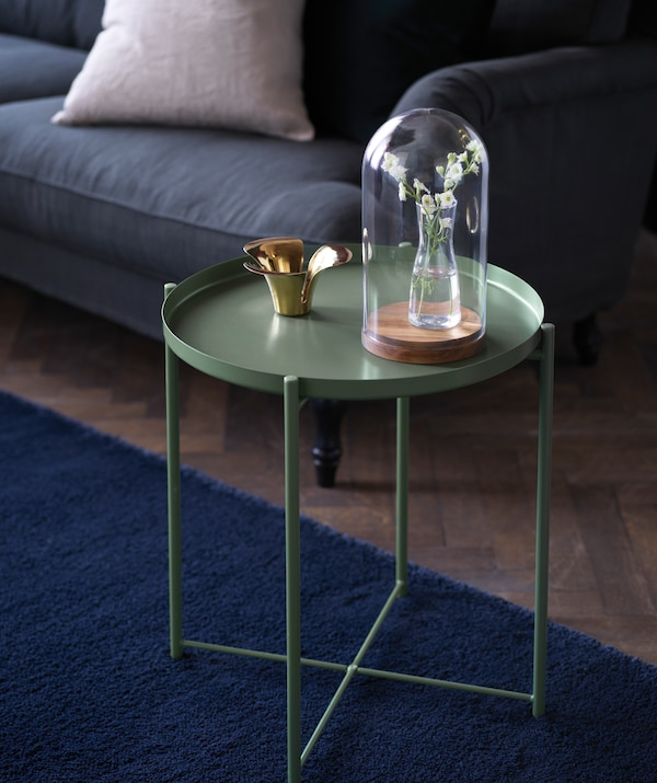 Give your living room a touch of the autumn trend at IKEA with this steel green GLADOM tray table.