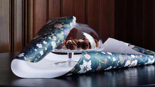 Glass cake stand wrapped in festive wrapping paper