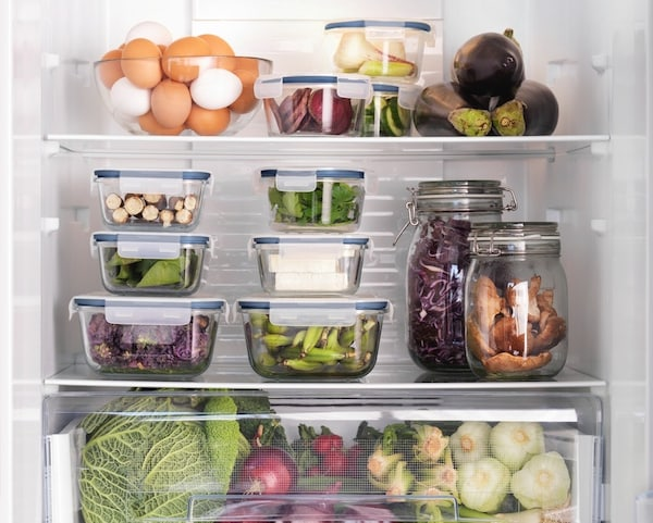 Glass jars and food containers used to organise a fridge