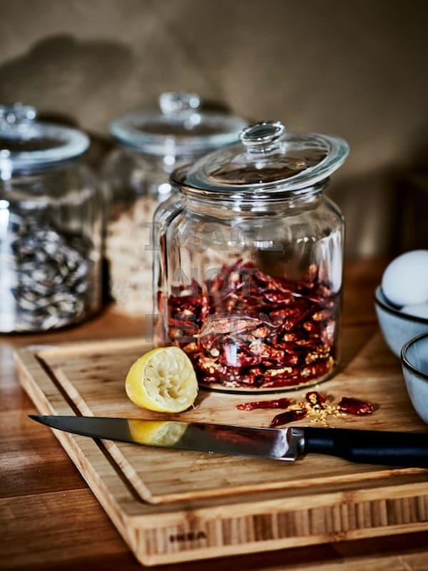 Glass jars with spices inside