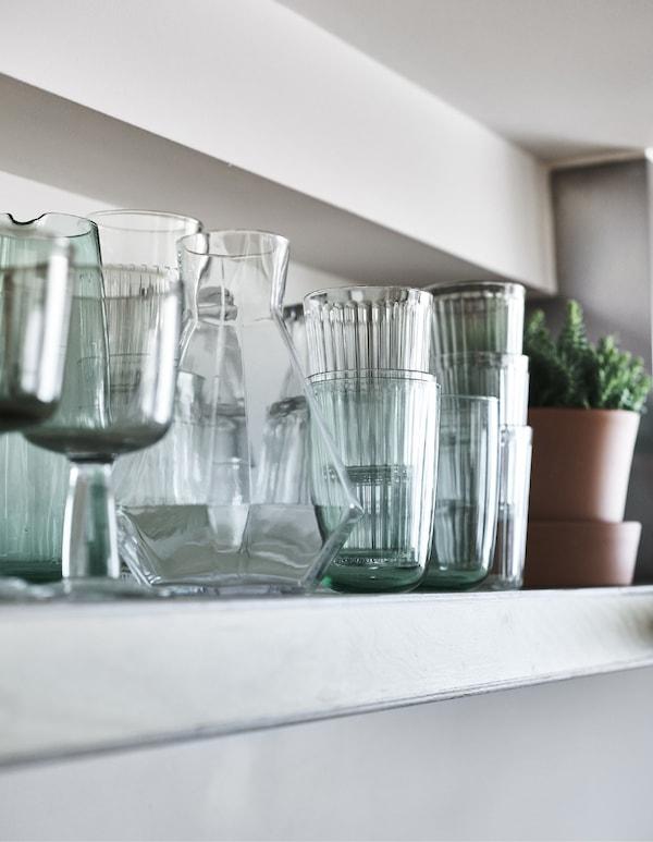Glasses on a kitchen shelf.