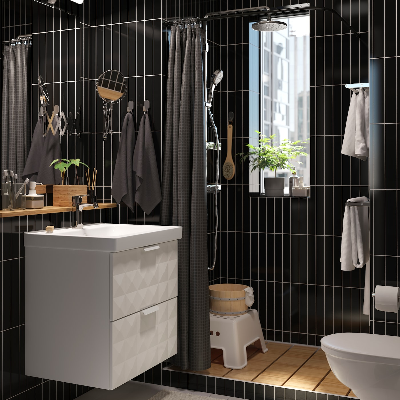 Go bold with a black-tiled small space bathroom and optimise storage space with GODMORGON wash basin with two deep drawers and wall cabinet with 5 shelves to store all your bathroom tools.