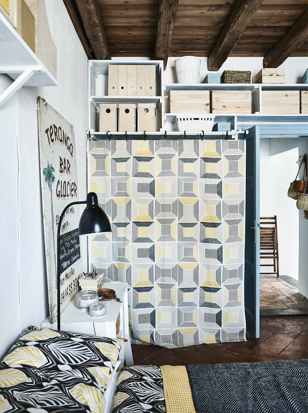 Graphic yellow, black-and-white textiles in a bedroom.