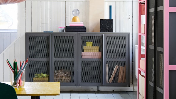 Gray cabinet with colorful box inside it.