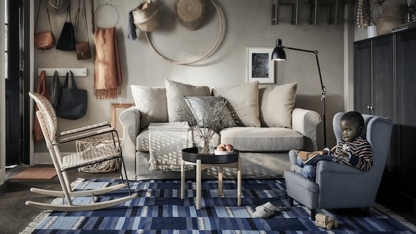 GRONLID beige sofa with cosy cushions and contrasting rug