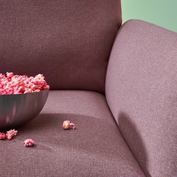 Gros plan sur le fauteuil inclinable EKOLSUND et sa housse lavable brun-rose