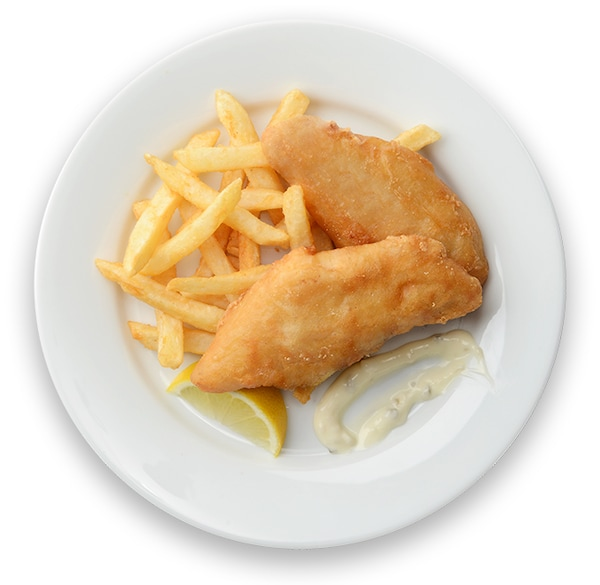 Haddock & chips on a white plate.
