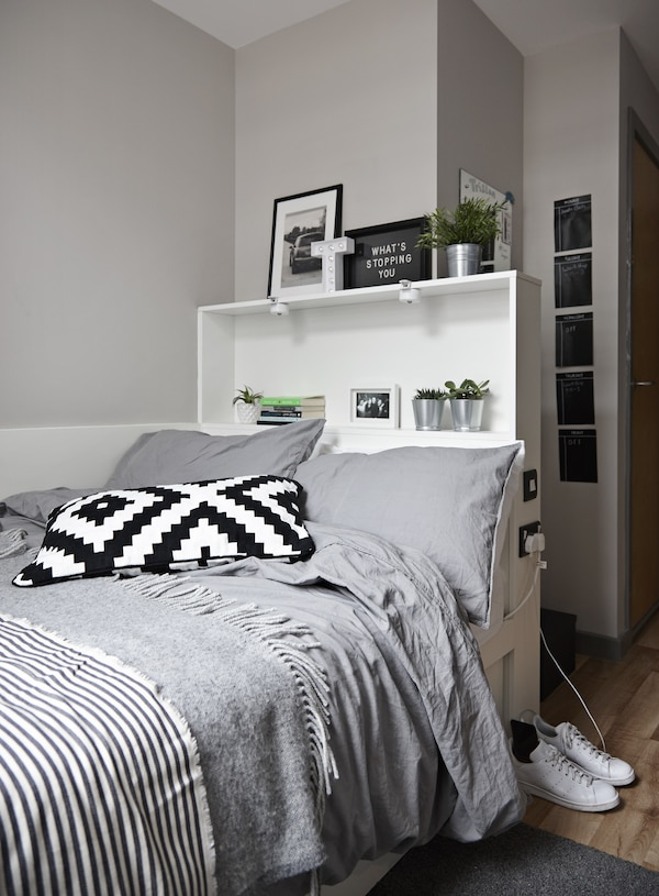 Halls bedroom and bed with grey, black and white bedding