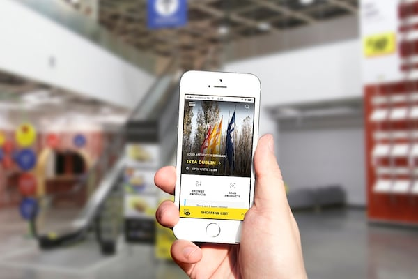 hand holding a mobile device displaying the IKEA Store App