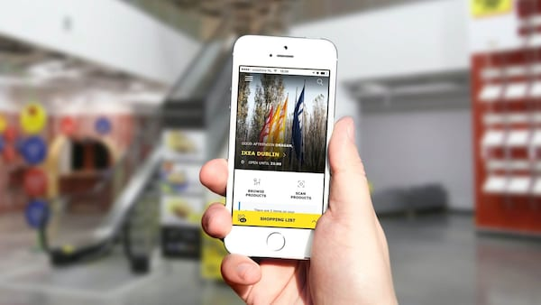 hand holding a phone showing IKEA app