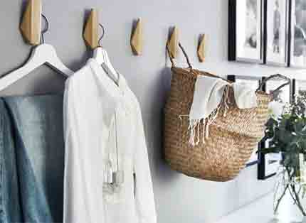 Hang clothes and accessories on SKUGGIS bamboo hooks to add extra room storage