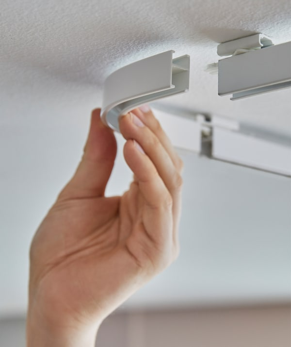 Hanging curtains from the ceiling is easier with VIDGA tracks from IKEA. Each mount needs only one screw and the rest clicks together. VIDGA glider/hook in white comes in a 24-pack and rolls in, so you can quickly attach or swap curtains.