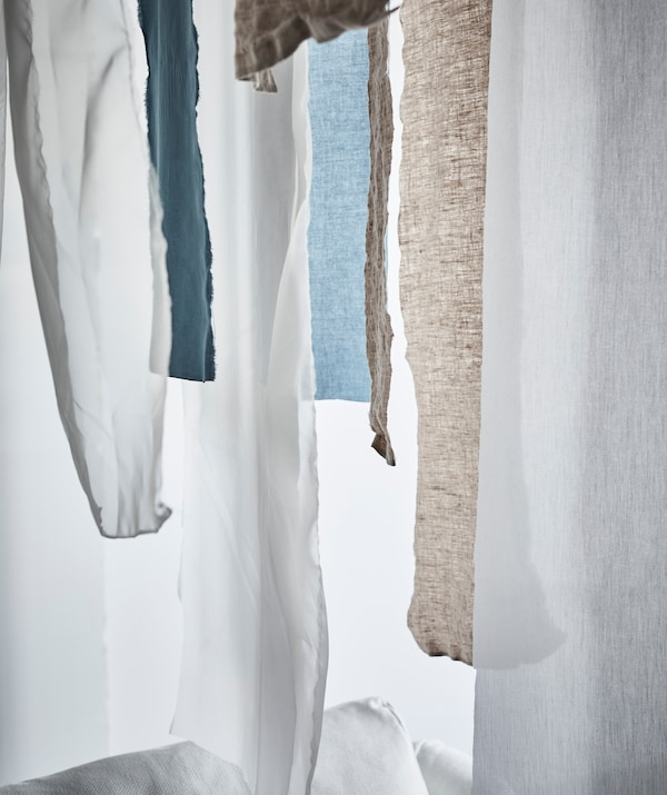 Hanging textile fabric – from individual strips to entire curtains – is effective both as decoration and to control light and temperature.