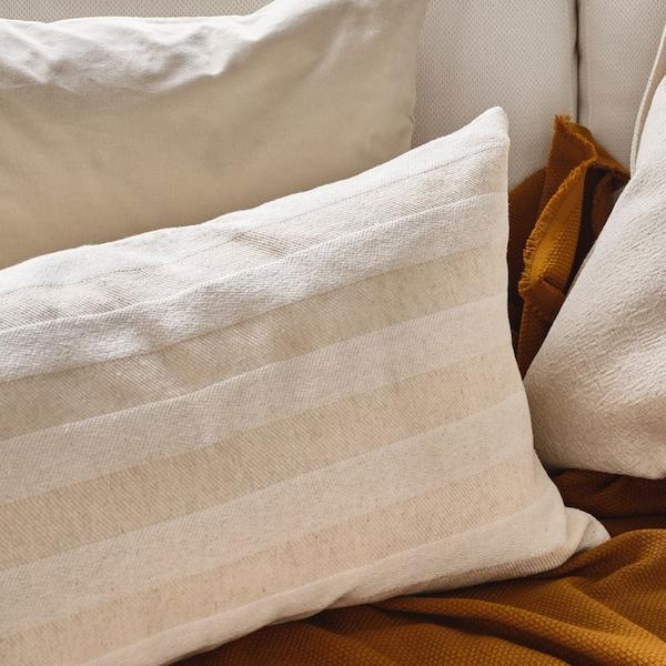 HEDDAMARIA natural striped cushions on sofa