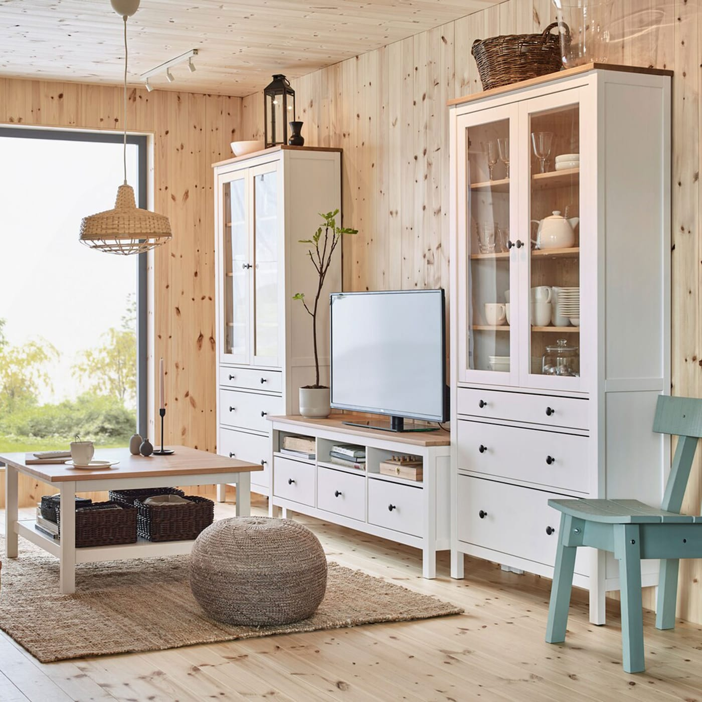 HEMNES pine wood furniture series including tall cabinets with glass doors, coffee table and TV bench crafted from fresh, smooth pinewood.