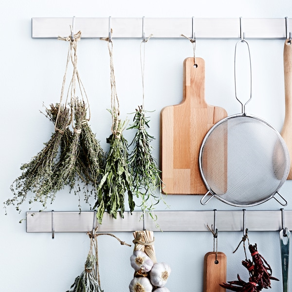 Herbs can be kept longer (while keeping their flavour) by drying them out. Just hang them in bundles upside down somewhere warm and dry.