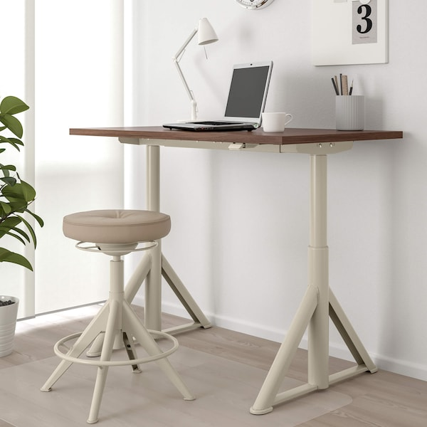 Home office with desk, laptop and lamp