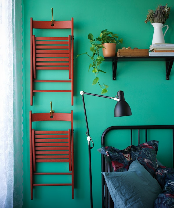 If you need more chairs than you've got space for, opt for folding chairs that can be hung on the wall when they're off duty.