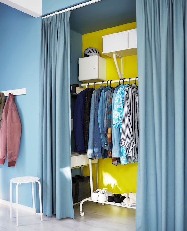 If you only have one storage space in your studio, maximise it with shelving, boxes and a clothing rack.