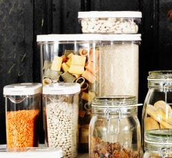 IKEA 365+ clear jars with white lids filled with various dry goods.