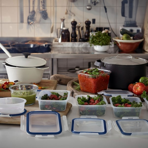IKEA 365+ containers sitting in a row on kitchen counter for meal prepping.