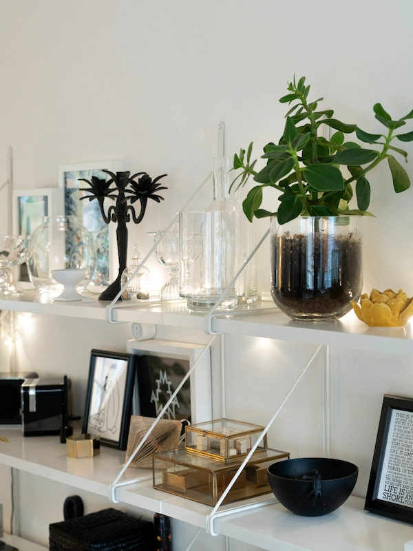 IKEA accessories are shown to their best advantage on the wall shelf.