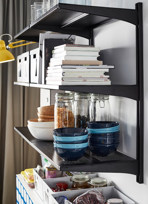 IKEA ALGOT black shelving units can be mounted together to create a long storage system or pantry for plates, glasses, boxes and items. Use it in the dining room or anywhere around the home.