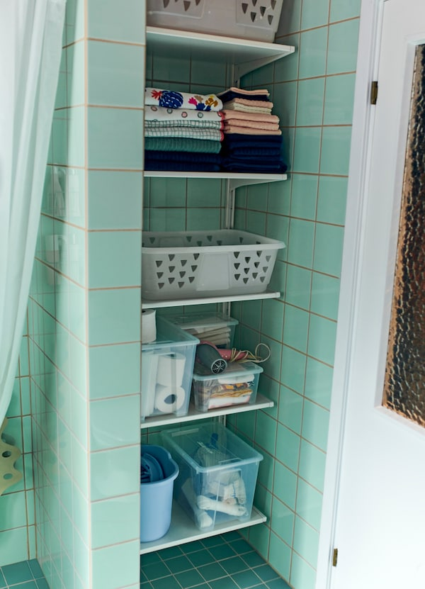 IKEA ALGOT white customisable wall shelves make storage simple. Click the brackets onto the wall uprights to add a shelf. It's easy to add or remove parts.