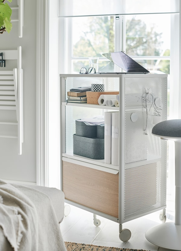 IKEA BEKANT white storage unit comes on castors as a portable storage unit and cabinet. Hang magnets and hooks on its mesh sides for more flexibility.