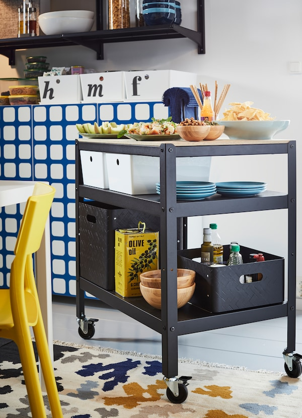 IKEA BROR black trolley comes with castors, two bottom shelves and a smooth pine plywood surface. Roll it around the home and store tableware, boxes and baskets underneath.