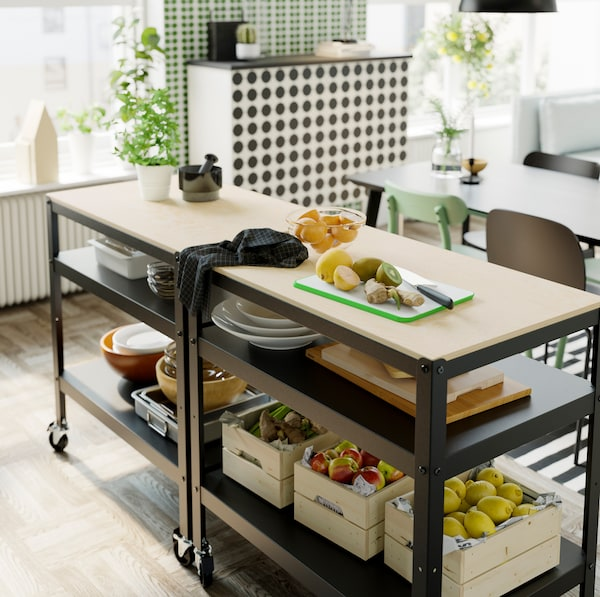 IKEA BROR black trolley with a light pine and plywood countertop, storing KNAGGLIG pine boxes on its two shelves.