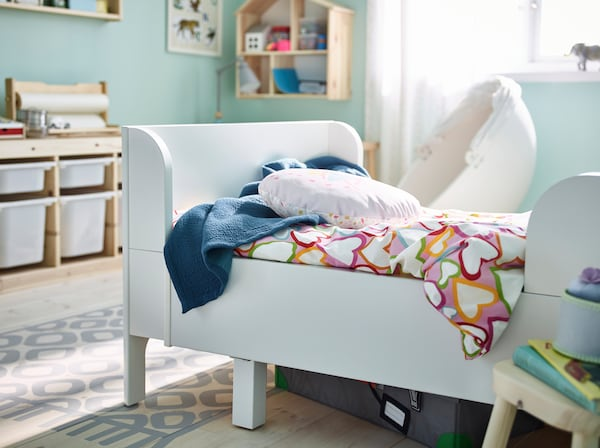 IKEA BUSUNGE white bed with extendable bedframe.