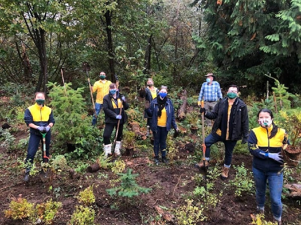 IKEA Coquitlam and Richmond co-workers planting trees, smiling with masks.