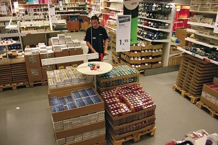 IKEA coworker working with pallets of food items