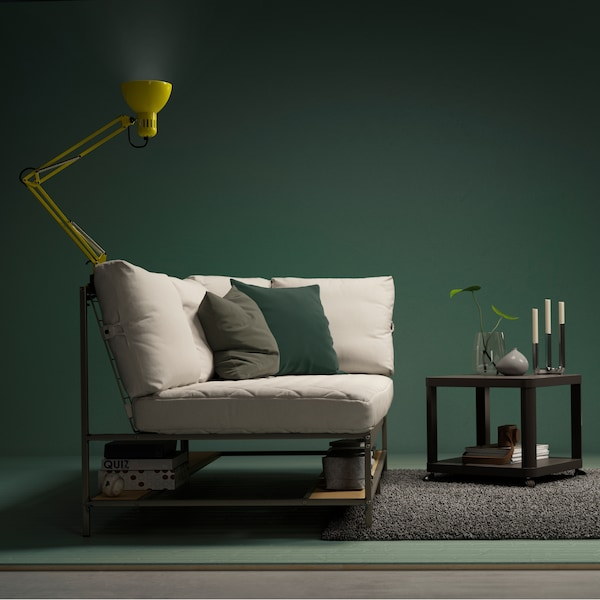 IKEA EKEBOL sofa with green and gray pillows