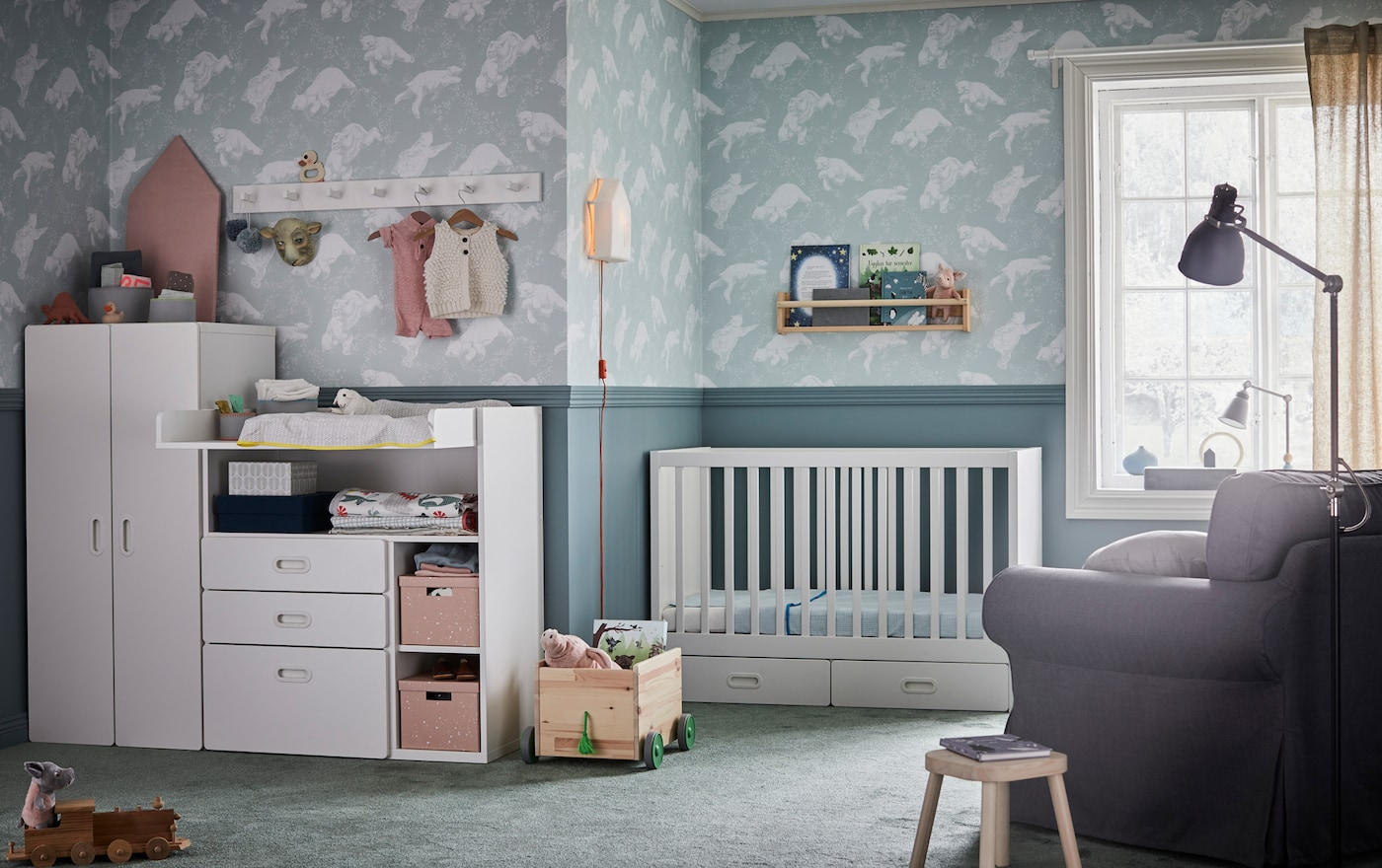 IKEA EKTORP large grey armchair with grey LEN nursing pillow in a nursery roomset.