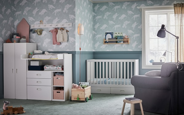 IKEA EKTORP large grey armchair with grey LEN nursing pillow in a nursery roomset.