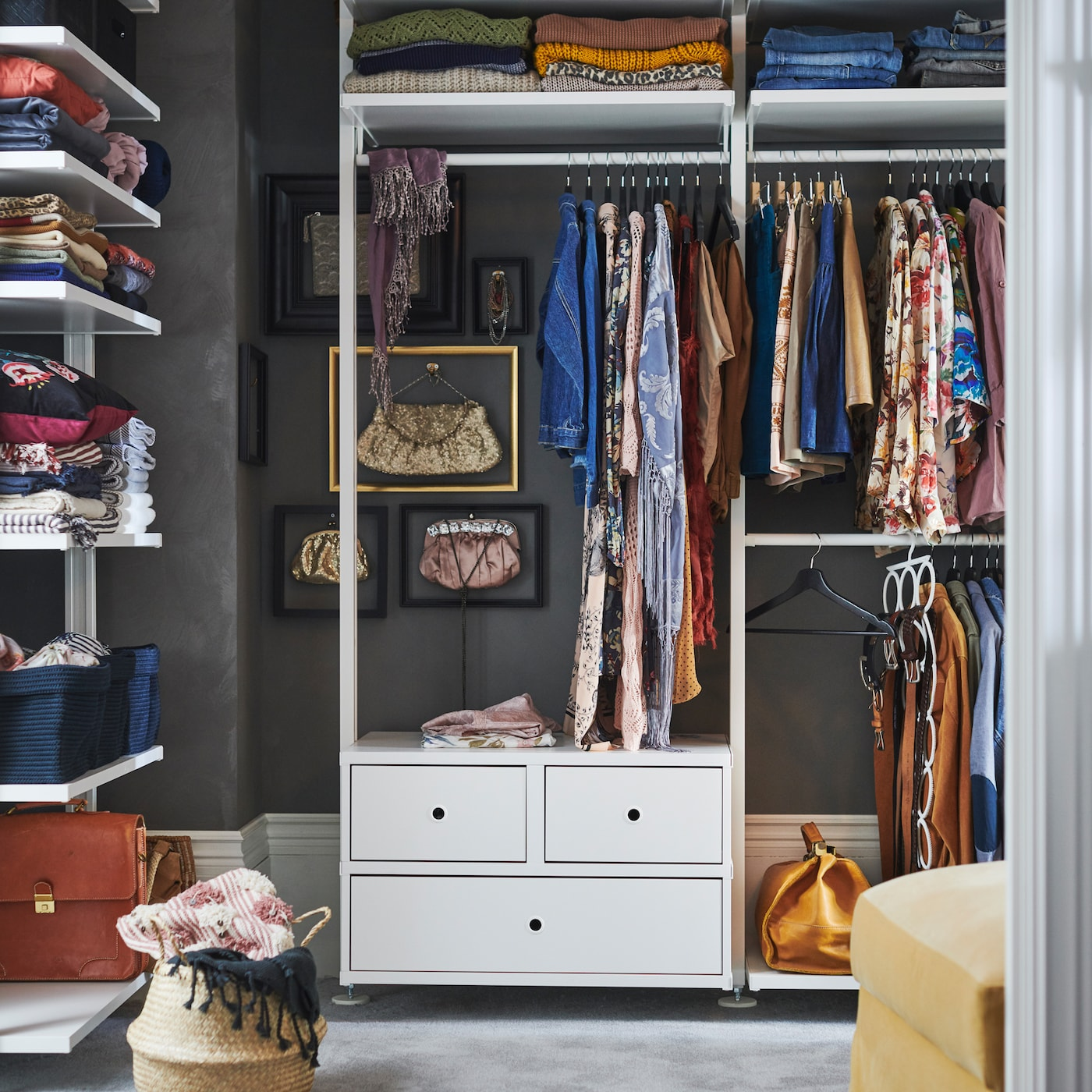 IKEA ELVARLI white open storage wardrobe solution, with clothes rails, closed drawers, and shelves.