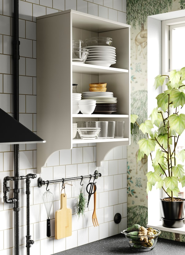 IKEA FINTORP black rail with black hooks hanging essential kitchen utensils.
