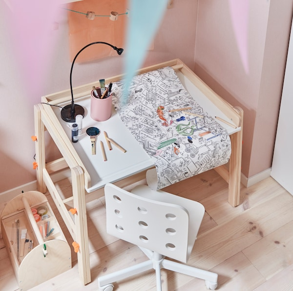 IKEA FLISTAT children's pine work desk with colour pencils and doodles.