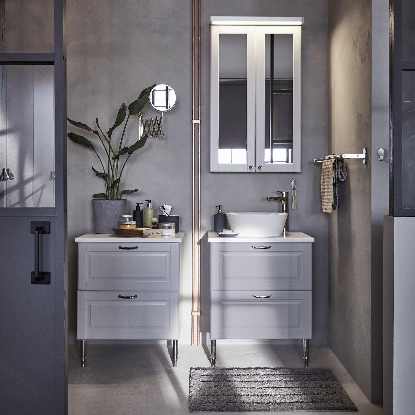 IKEA GODMORGON light grey bathroom wash cabinets and drawers are made from solid wood, while the smooth melamine countertop hides fingerprints and splash marks.